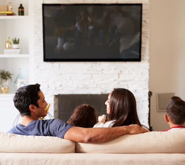 family watching tv mounted on wall