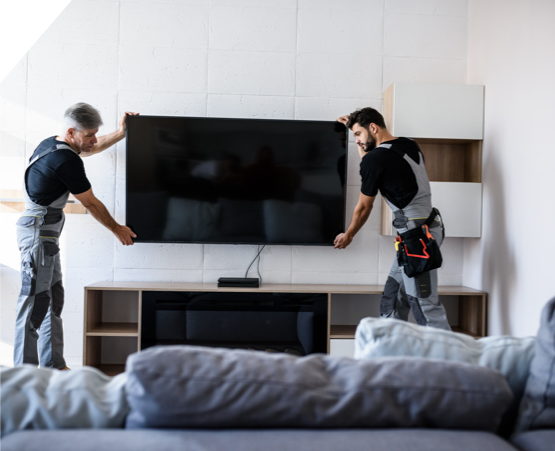 two men mounting tv onto wall